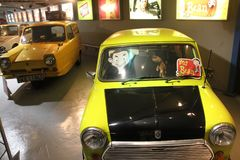 Replica of the mini cooper and teddy bear from Mr. Bean in England in the summer. Stock Photo