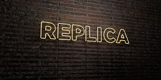 REPLICA -Realistic Neon Sign on Brick Wall background - 3D rendered royalty free stock image Royalty Free Stock Photo