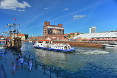 Replica of sail ship and a tourist ship. Replica of an old wooden galeon with square rigging and a tourist ship mooring in the Old City of Gdansk, northern Stock Photography