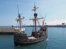 The replica santa maria sailing ship leaving funchal harbor for a cruise around madeira. Funchal, madeira, portugal - 17 march 2019: the replica santa maria royalty free stock image