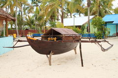 Replica of traditional Papuan boat. In turistic village Arborek (Raja Ampat, Papua Barat, Indonesia stock photos