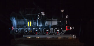 Replica Trains. Shrouded in smoke, a Replica Trains on a black background stock photo