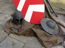 Replicas of medieval helmets, shields and swords Royalty Free Stock Images