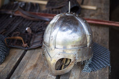 Replika of Vikings helmet on wooden table Royalty Free Stock Photography