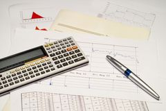 Report. Financial reports with calculator and pen Royalty Free Stock Photos