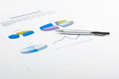 Report. Pen laying on report with diagrams Royalty Free Stock Images