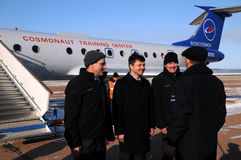 Report Upon Arrival in Baikonur. BAIKONUR, KAZAKHSTAN - DECEMBER 8: Increment 31 crew (L-R: Don Petit, Oleg Kononenko, Andre Kuipers) are greeted by Deputy Chief Royalty Free Stock Images