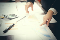 Report. Business man in office with charts. Close up royalty free stock image