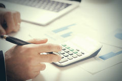 Report. Business man in office with charts. Close up stock images