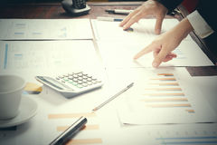 Report. Business man in office with charts. Close up stock photos