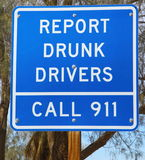 Report Drunk Drivers Sign. Highway report drunk drivers sign by calling 911 royalty free stock image