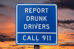 Report Drunk Drivers Sign with Sunset Stock Photography