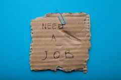 Report on finding a job on a piece of cardboard box stock image