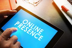 Report about Online Presence. Man is holding report about Online Presence Stock Photos