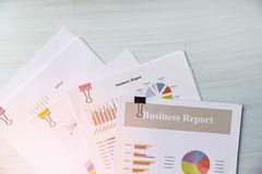 Report paper document present financial business report graph chart on office table background royalty free stock photo