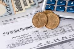 Report of a personal budget with dollars, coins Stock Image