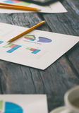 Report quarterly sales chart and pencil on the workplace closeup Royalty Free Stock Images