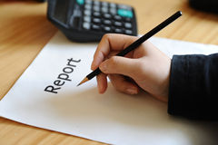 Report write. Annual report write with pen royalty free stock photography
