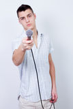 Reporter. Journalist young man holding a microphone and interview Stock Images