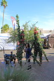 USA, AZ/Tempe: Festival Entertainment - Interview With Stilt Walkers in Tree Costumes Royalty Free Stock Images