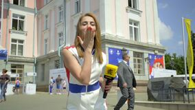 Misk, Belarus - June 21, 2019 Reporter, correspondent sends a kiss to the camera.
