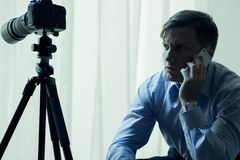 Reporter or detective at work. Talking on the phone Stock Photos