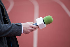 Reporter holding microphone Royalty Free Stock Images