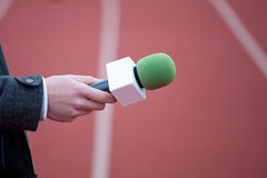 Reporter holding microphone. For interview Stock Photos