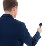 Reporter holding microphone isolated on white background. Young reporter holding microphone isolated on white background Stock Photos
