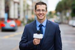 Reporter live broadcasting. Professional news reporter live broadcasting on urban street Stock Photography