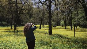Reporter makes photos of a blooming natural reserve for publication in magazine