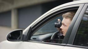 Reporter making photo of vip woman secretly from his car, gutter press sensation
