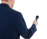 Reporter with microphone isolated on white background Stock Photography