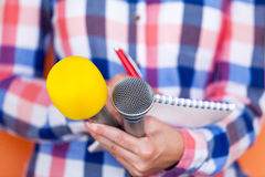 Reporter. News conference. Press interview. Microphone. Royalty Free Stock Image