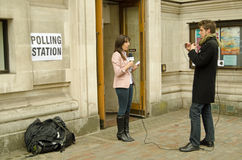 Reporter at Polling Station during General Election Stock Photo