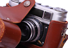 Reporter's camera in a leather case. Royalty Free Stock Photos
