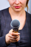 Reporter taking interview or opinion poll. Reporter with microphone taking interview or opinion poll Stock Photography