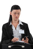 Reporter wearing visitors badge Royalty Free Stock Photo