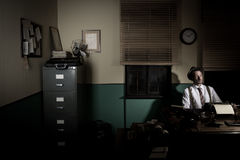 Reporter working late at night Royalty Free Stock Photography