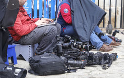 Reporters and equipment at work Stock Images