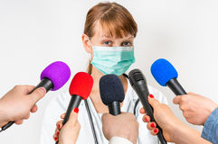 Reporters making interview with female doctor Royalty Free Stock Image