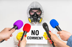 Reporters making interview with man in gas mask Royalty Free Stock Image