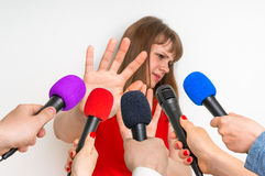 Reporters making interview with young woman Stock Image