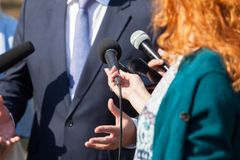 Reporters making media interview with business person or politician stock images