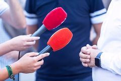 Reporters making press or media interview royalty free stock image