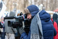 Reporters, photographers and bloggers working at a march. Moscow, the Russian Federation - February 25, 2018: Opposition march in memory of the politician Boris Stock Images