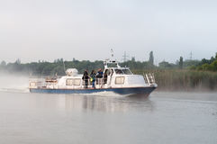 Reporters sail on a pleasure boat on the reservoir of Kursk NPP Royalty Free Stock Photos
