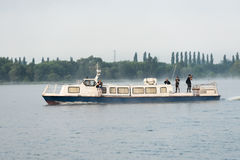 Reporters sail on a pleasure boat on the reservoir of Kursk NPP Stock Image