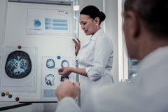 Scientist reporting her research results to the colleagues royalty free stock images