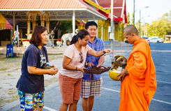 The reporting from the street, ritual of a gift of food for monk Stock Photo